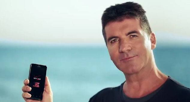 simon cowell throws cell phones